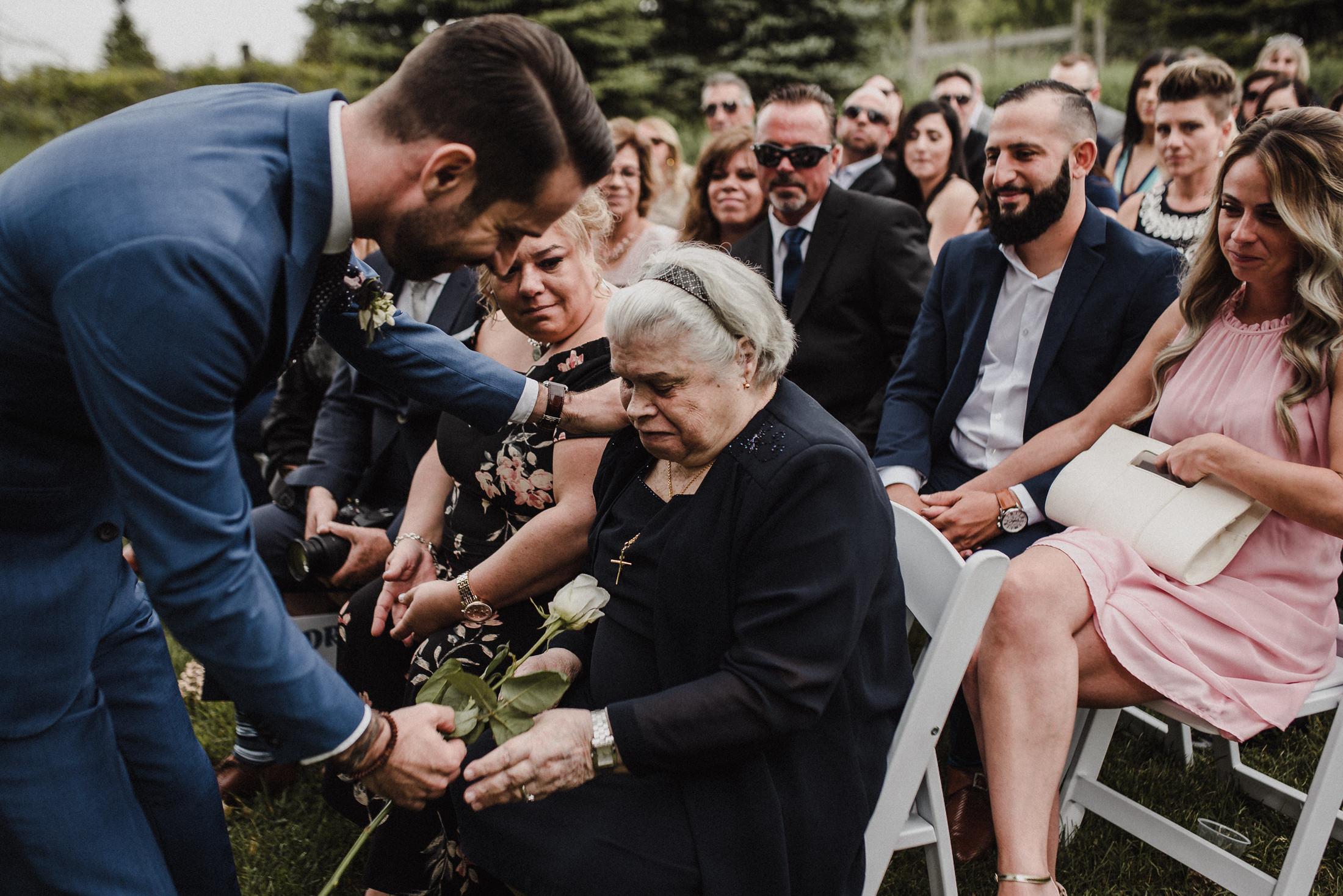 handing rose to grandma