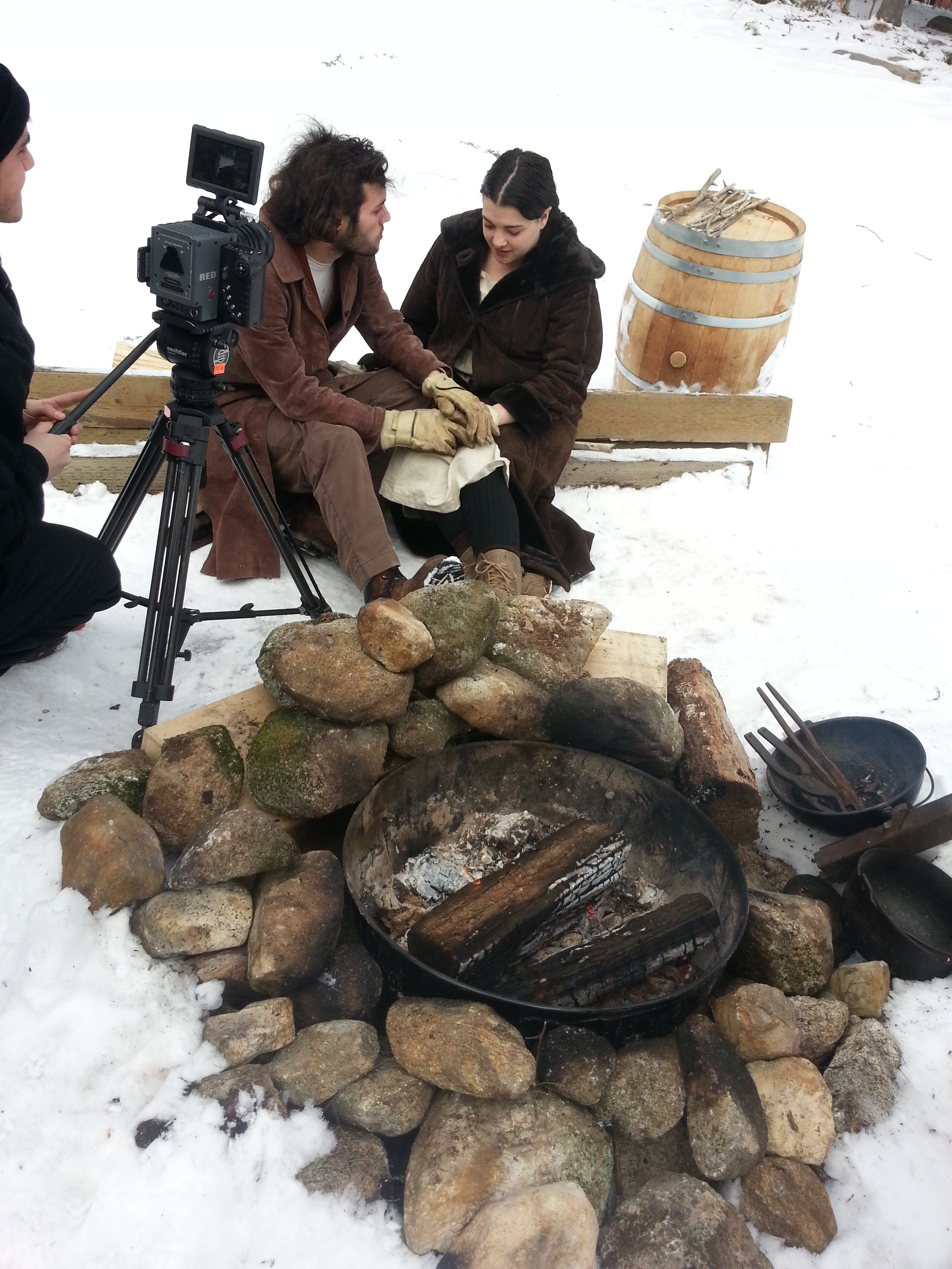 Filming their falling in love by a fire