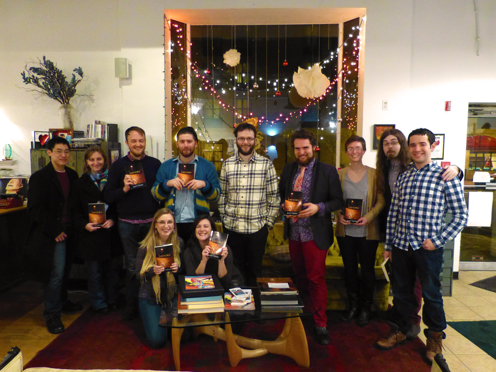 """Center, Author Matt Seidel. Group holding the new release of his thriller novel, Saviors. Holon Publishing """"Wine & Sign"""" event from early 2014."""