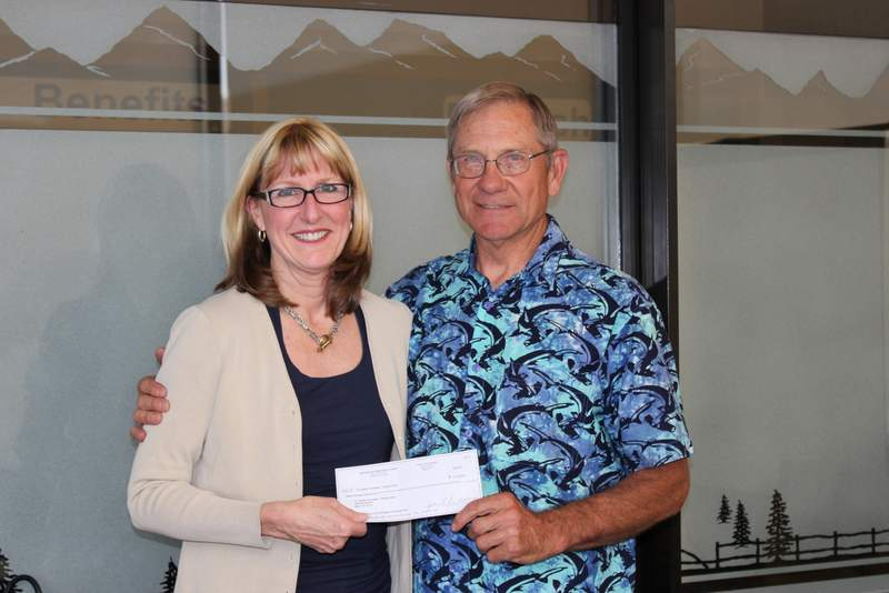 Myrna Dow (Quilt Show board member and High Desert Frameworks founder) present the 2013 $12,000 donation to Al Huntley of Wendy's Wish.