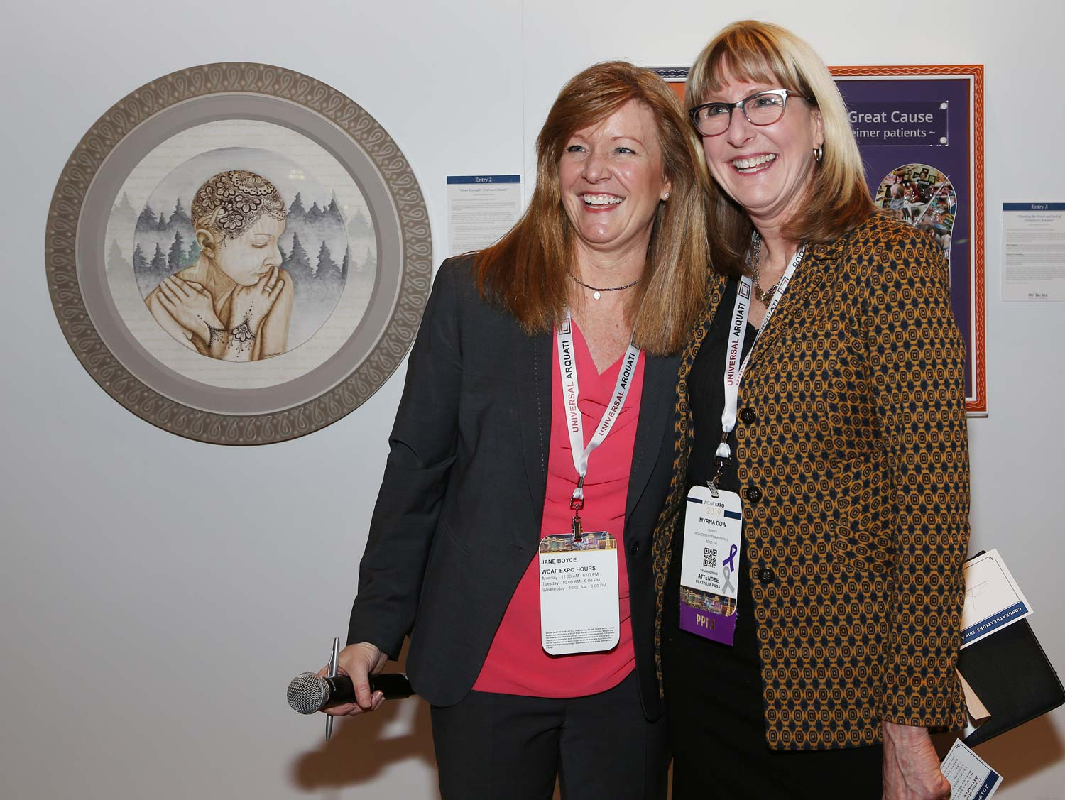 Myrna Dow (right), President and Founder of High Desert Frameworks Inc, Bend Oregon with Jane Boyce (left), President Tru Vue Inc. Photo Credit Mark Wallenfang 2019. West Coast Art and Frame Expo 2019 Las Vegas NV.
