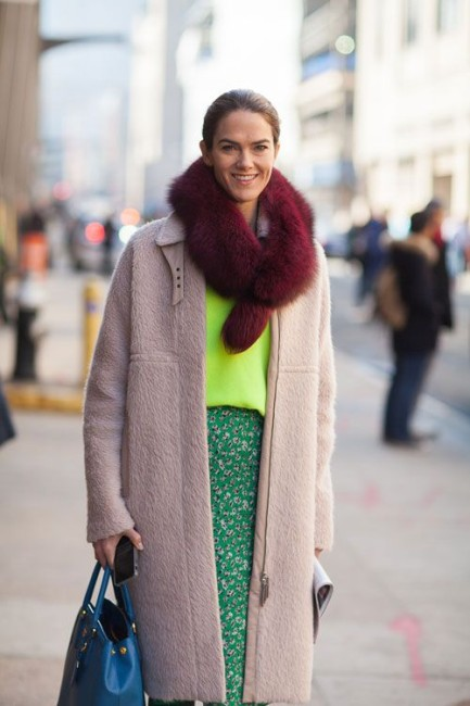 Introduce a contrasting color by wrapping it around your neck.