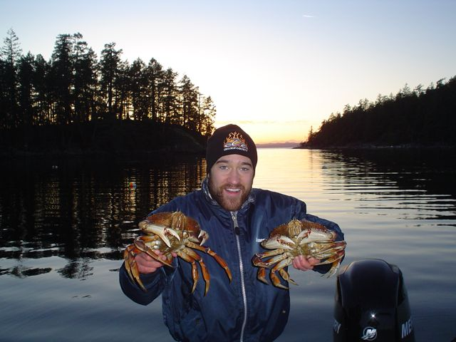 A happy trapper with two nice male dungeness crab.