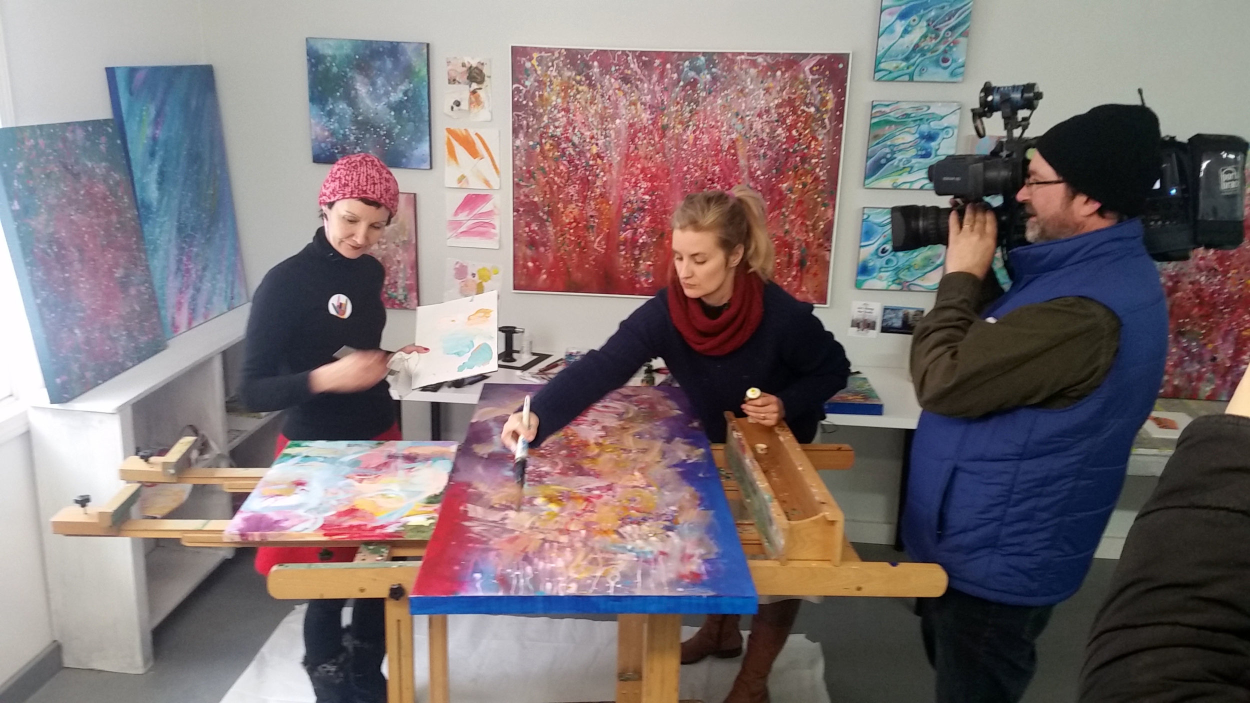 Rebecca Klementovich (left) and Kristen Pobatschnig painting in action appearing on WMUR's  New Hampshire Chronicle.