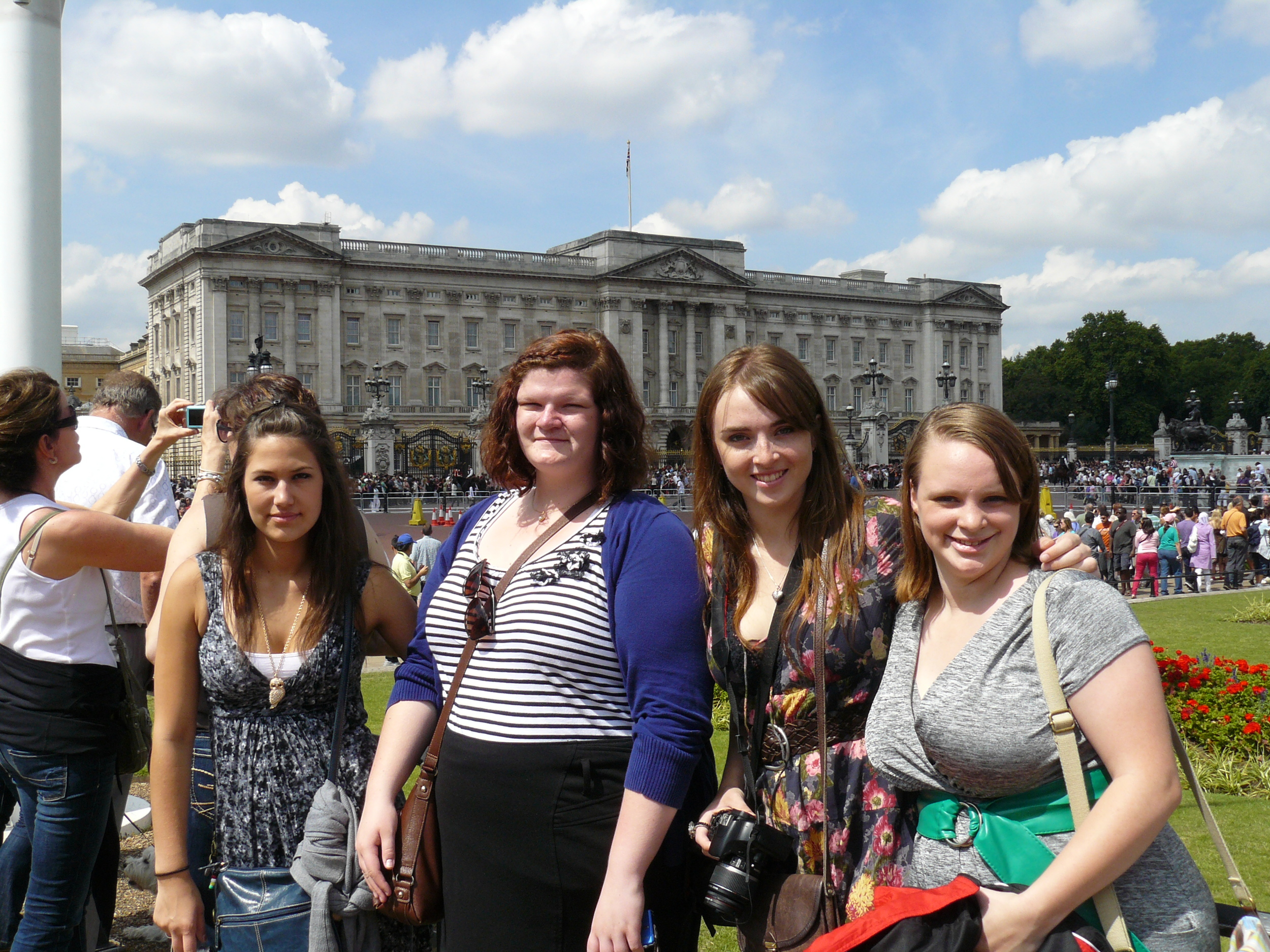 Four of our singers outside the front of Buckingham Palace.