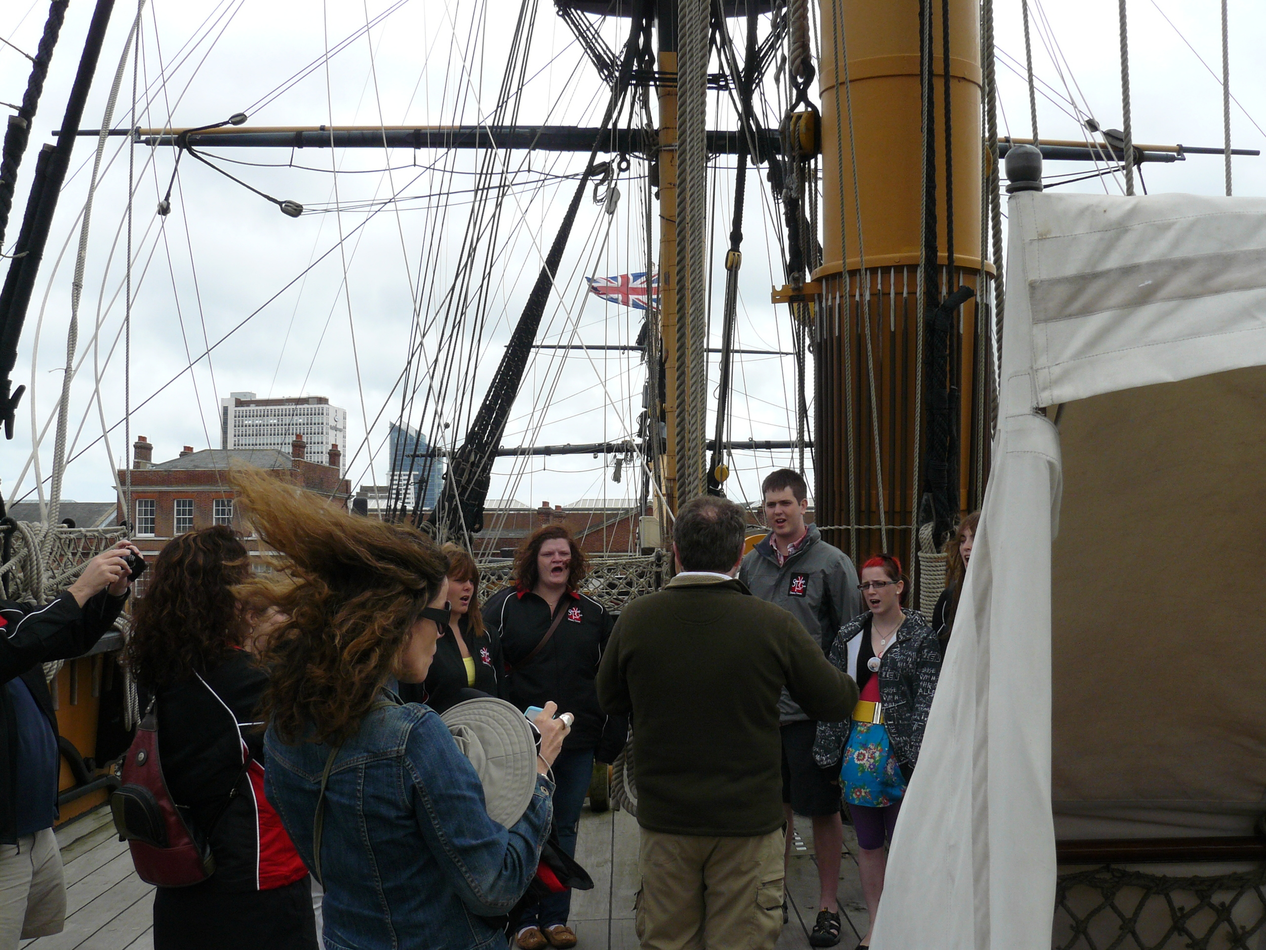 Singing on deck at the spot where Lord Nelson was killed. (it was a very windy day!)