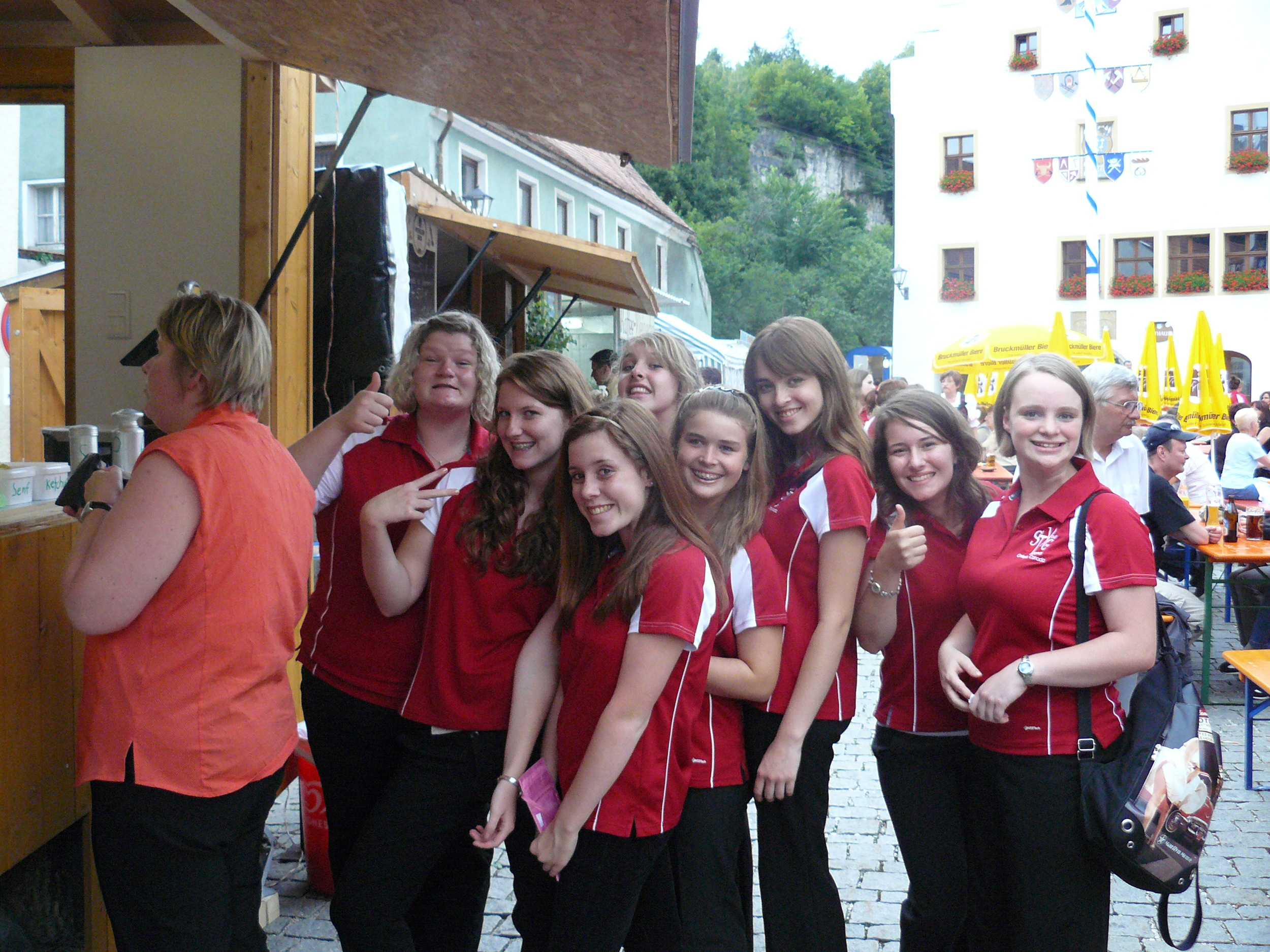 Waiting in line for German sausage before our performance in Amberg town square.