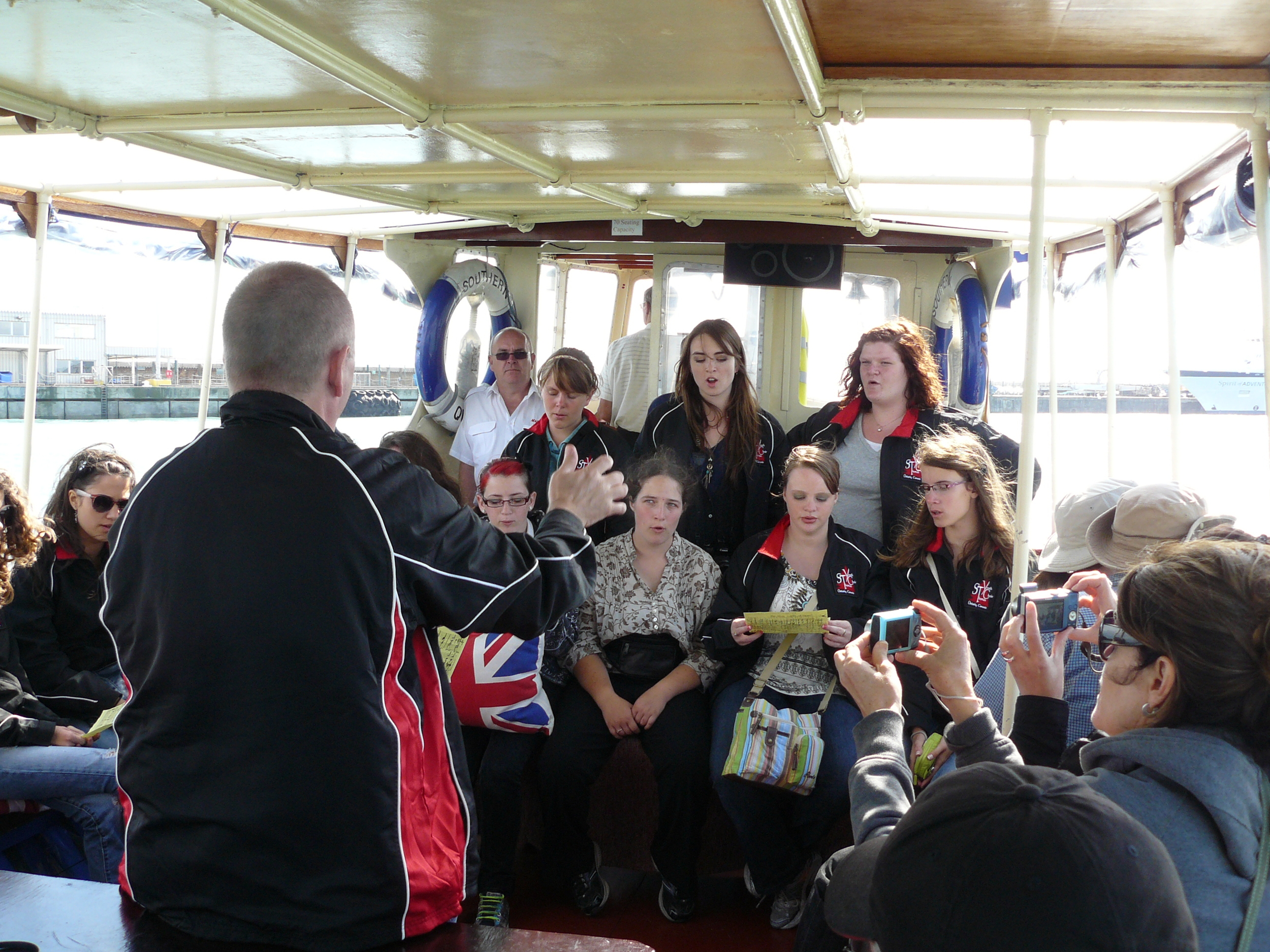 """Performing """"White Cliffs of Dover"""" on a boat just out from the cliffs themselves."""