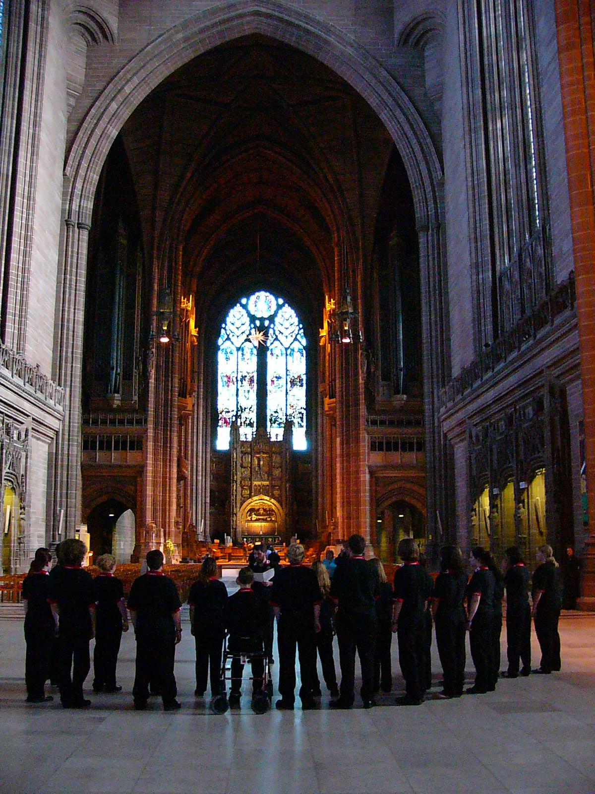 Singing in Liverpool Cathedral. It is the second longest and fifth largest cathedral in the world! It has an 8 and a half second reverberation time! We are standing under a bridge from one side of the cathedral to the other!