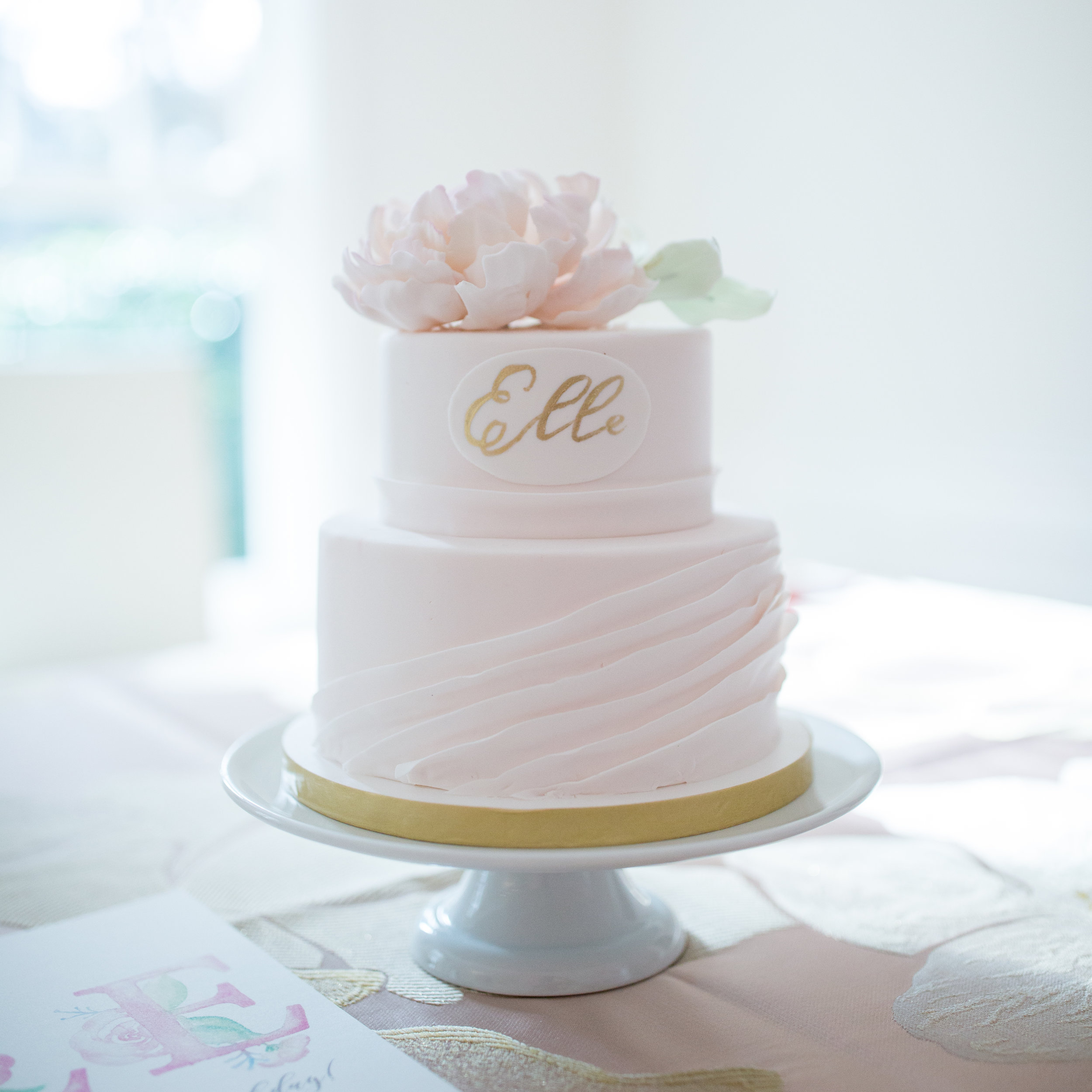 Ooh-lala! Baby pink ruffles on three tiers, created to perfection by  Nine Cakes .