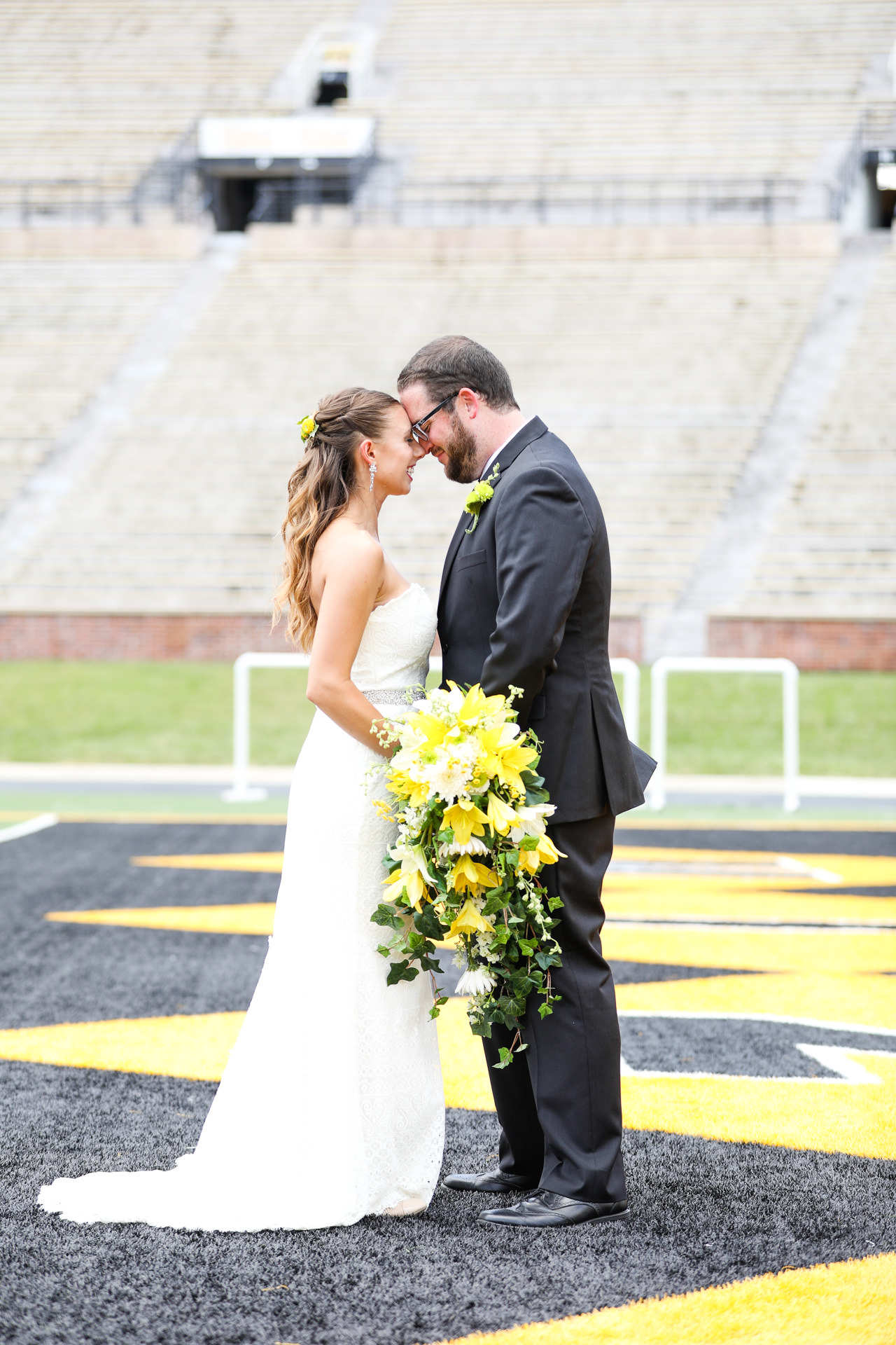 Trinity Lutheran Wedding and Mizzou Columns Club at Faurot Field Memorial Stadium Reception in Columbia MO photos by St Louis Wedding Photographers TJ and Nichole Oldani Photography