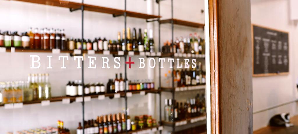 Window signage for the Bitters + Bottles South San Francisco Liquor Shop