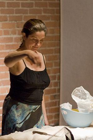 "Gina Bonati preparing the set for ""Cantaloupe"""