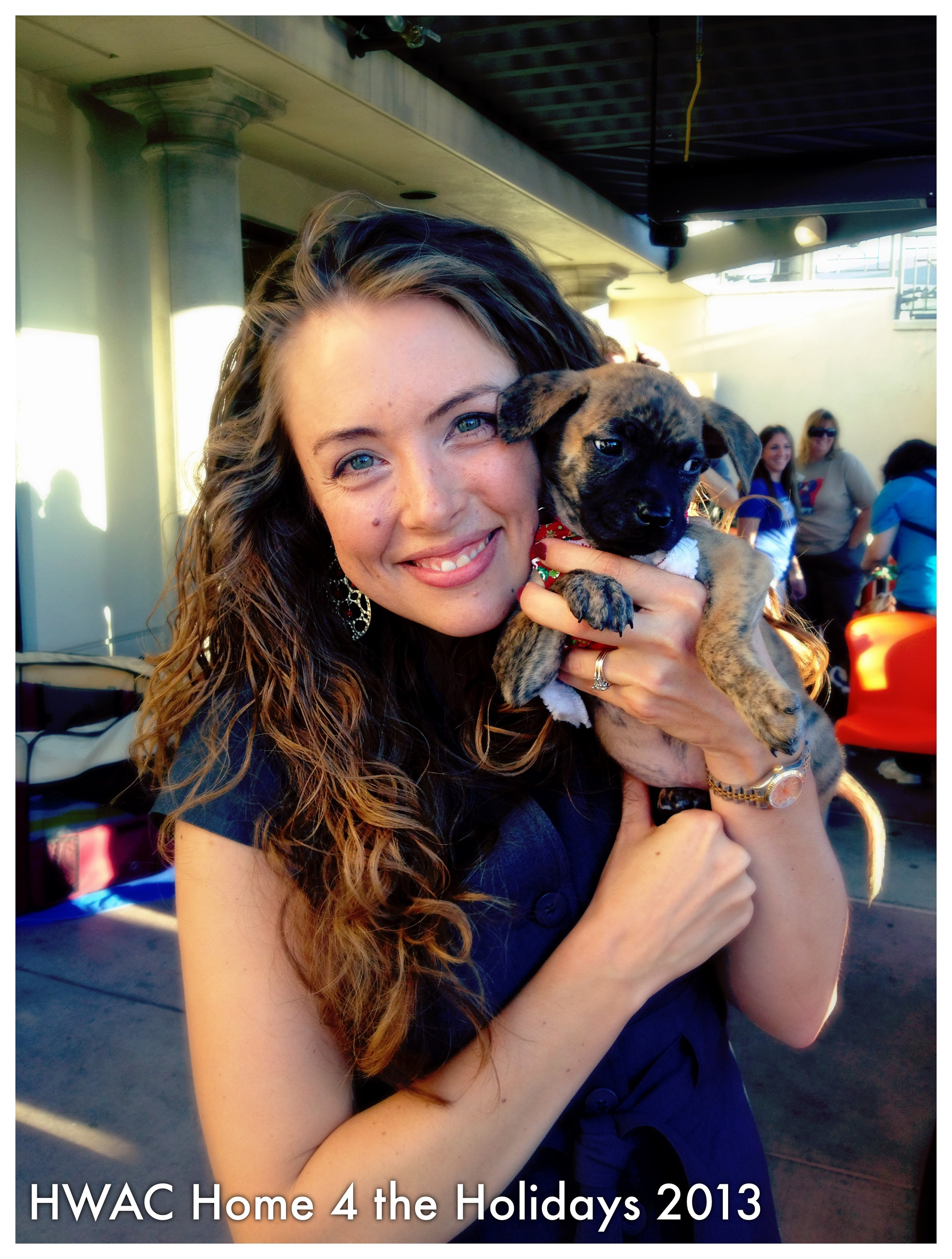 PHOTO: Amber snuggles with 9-week old puppy, up for adoption at HWAC