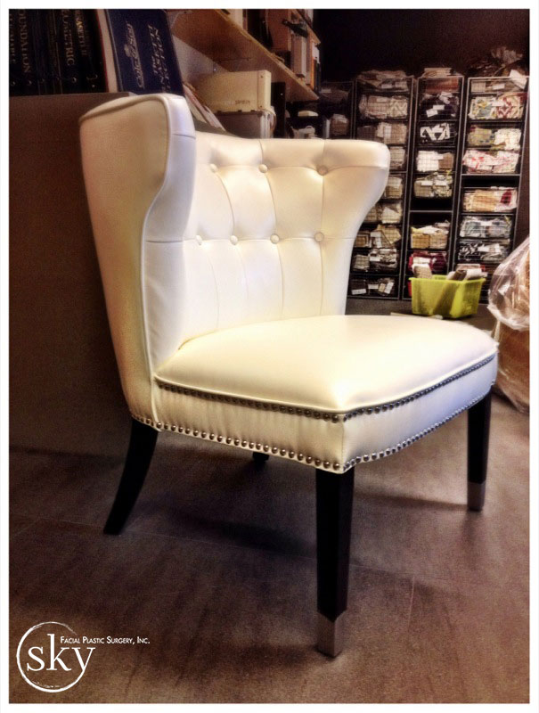 PHOTO: Off-white wing-backed guest chair.