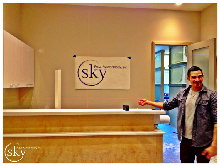 PHOTO: The SKY logo on paper, taped to the wall.