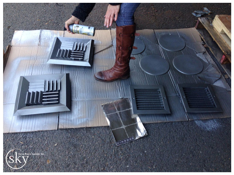 PHOTO: Air vents laying on the ground being spray painted.