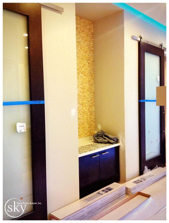 PHOTO: Honey onyx backdrop at handwashing station.