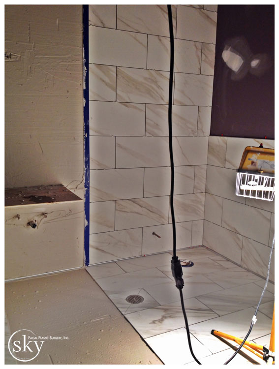 PHOTO: Bathroom, partially tiled.