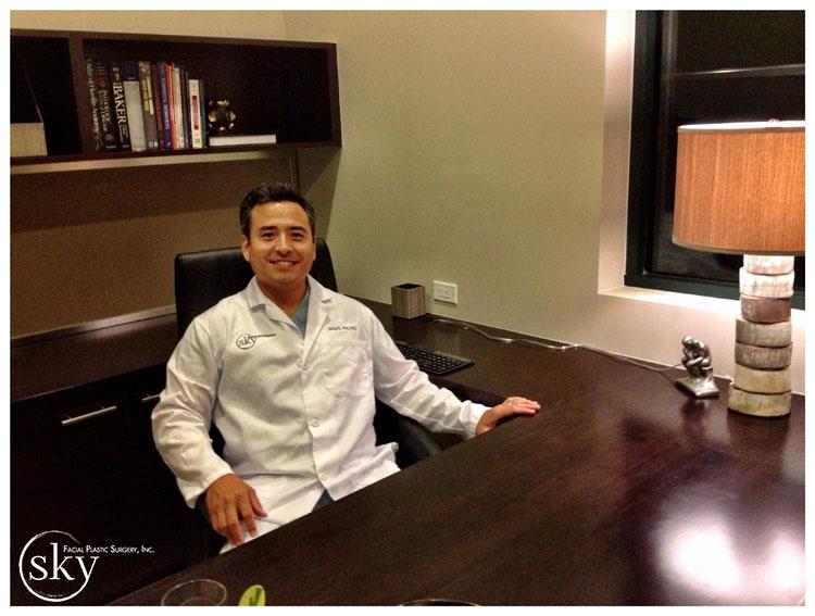 PHOTO: Dr. Yoo sitting at his desk.