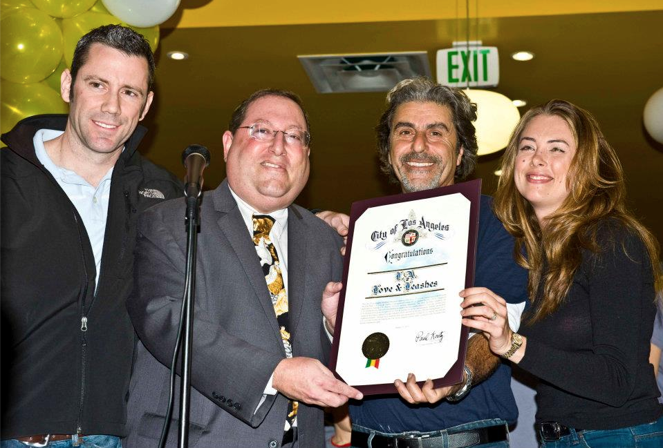 "Founding board member Amber (far right) accepting an award from Councilmember Koretz at the Jan. 2012 Grand Opening of Friend of L.A. Animal Shelter's trail-blazing ""shelter shop""."