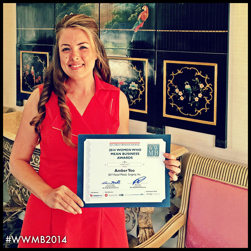 PHOTO: Vice President Amber N. Yoo, M.B.A. holding her certificate as finalist for San Diego Business Journal's Women Who Mean Business Award.