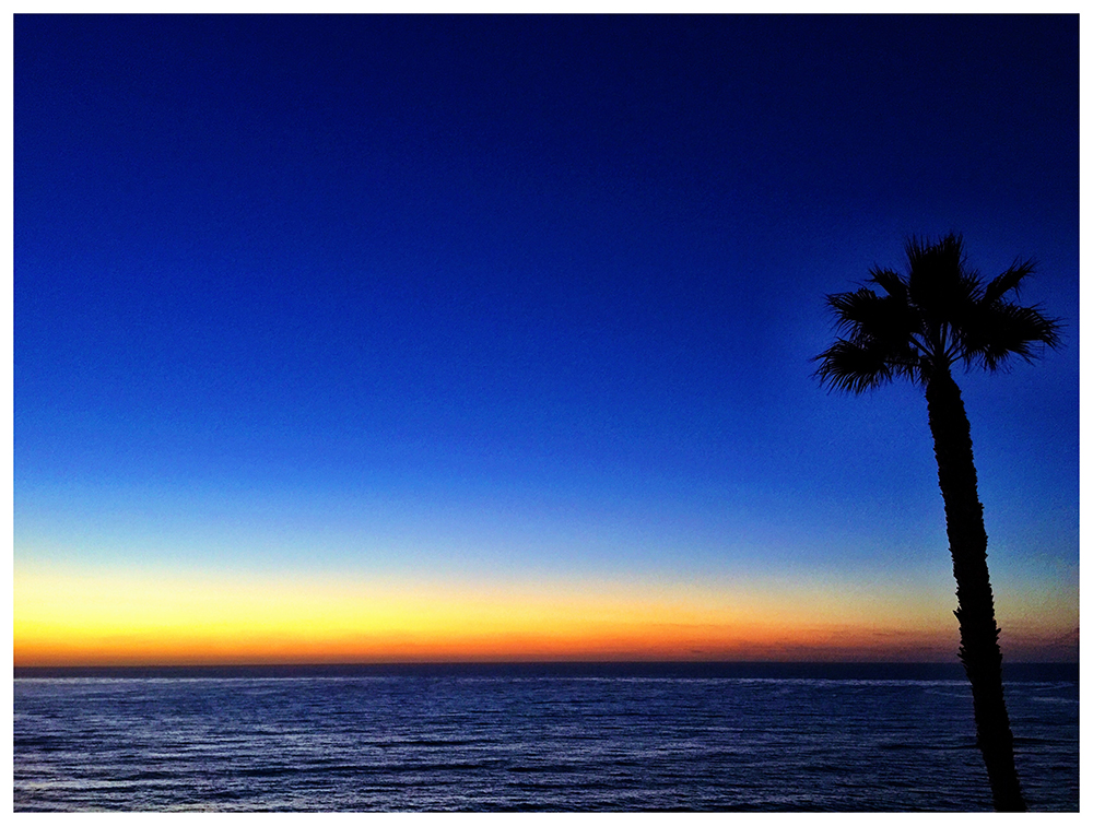PHOTO: The sun setting over the ocean; view from San Diego Magazine's Woman of hte Year event in La Jolla.