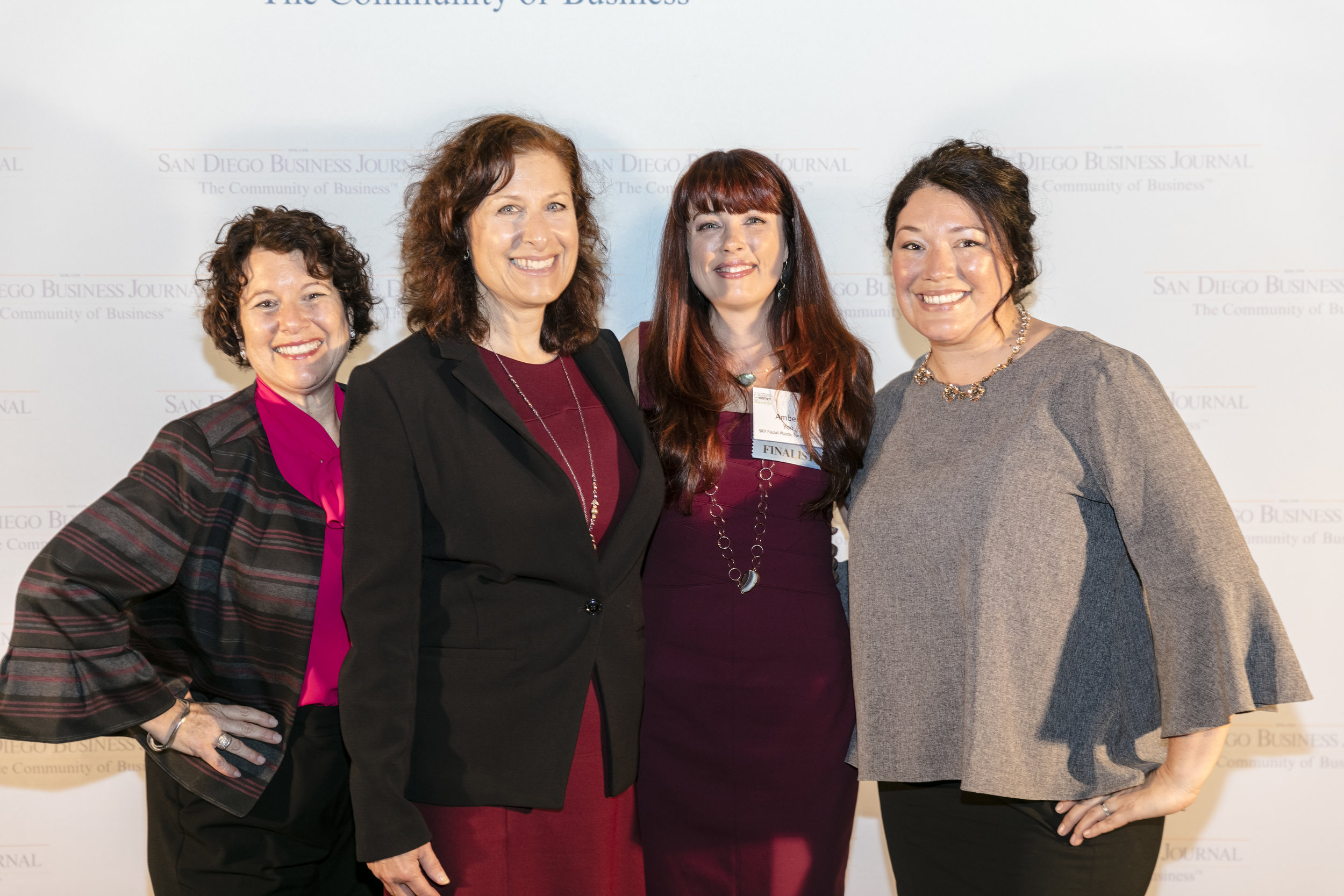Pictured from left to right: (1) Laurie Coskey, CEO of United Way (2) Lisa Kalal, VP of Philanthropy for United Way (3)  Amber Yoo, Finalist and SKY's VP  (4) Adina Veen, Community Engagement Manager of United Way | Photo by Bob Thompson ©2017