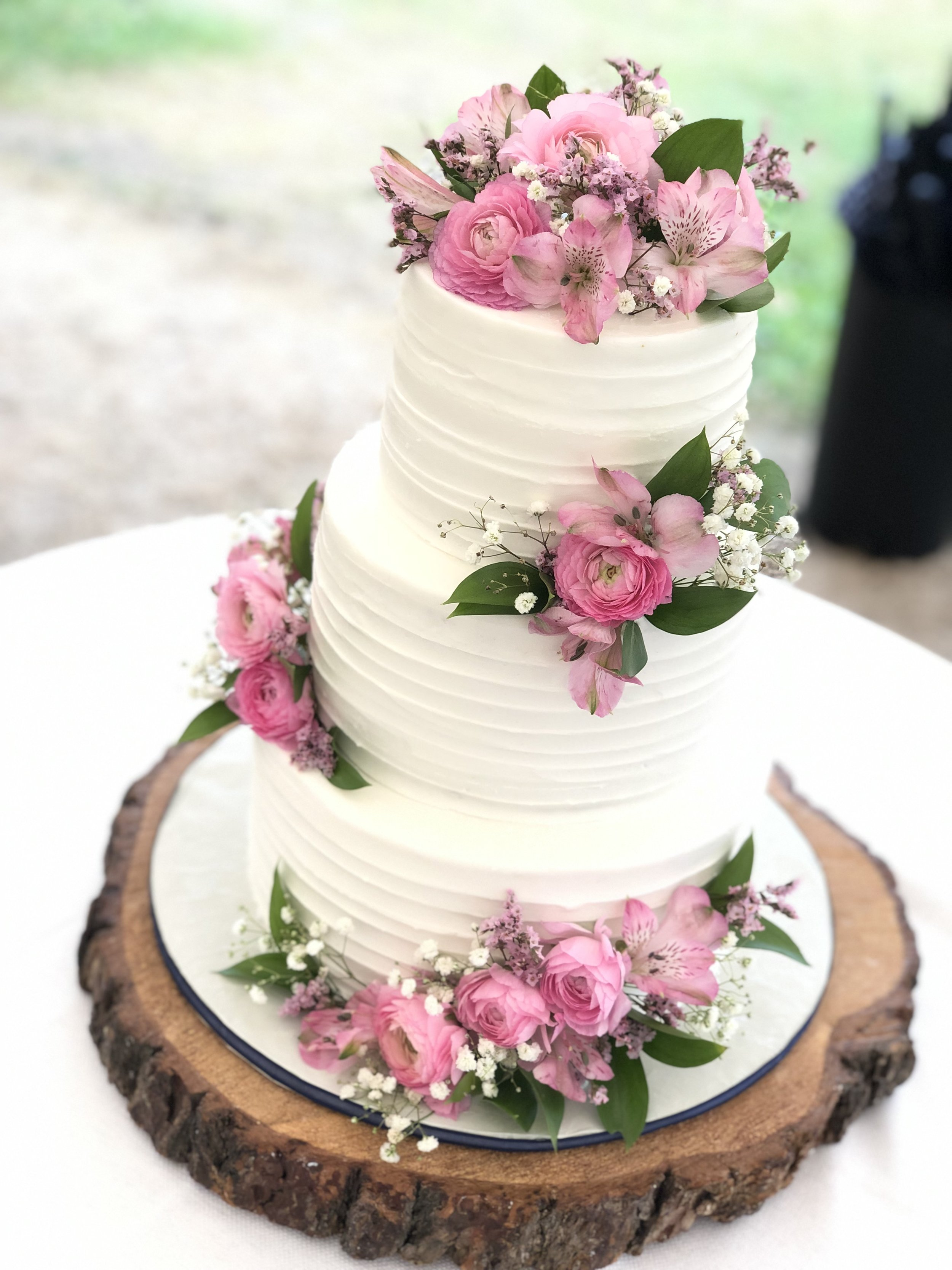 Textured Buttercream - You can choose your style of icing texture.You can add an ombre colors for an additional charge.Includes fresh flower arrangementIncludes a custom board to match(size shown: 74 servings)