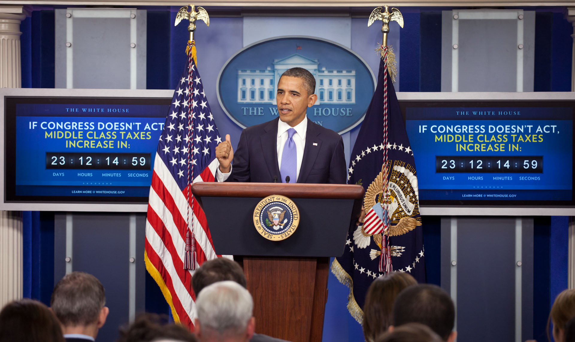 President Obama stands in front of the middle class tax cut countdown clock in the Press Room in December 2011.