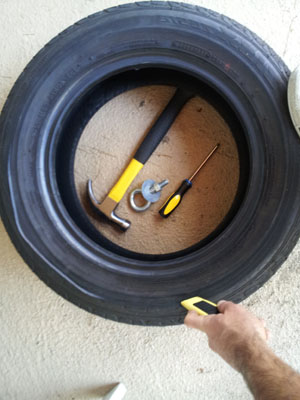 Use a box cutter t cut the tire sled for loading.