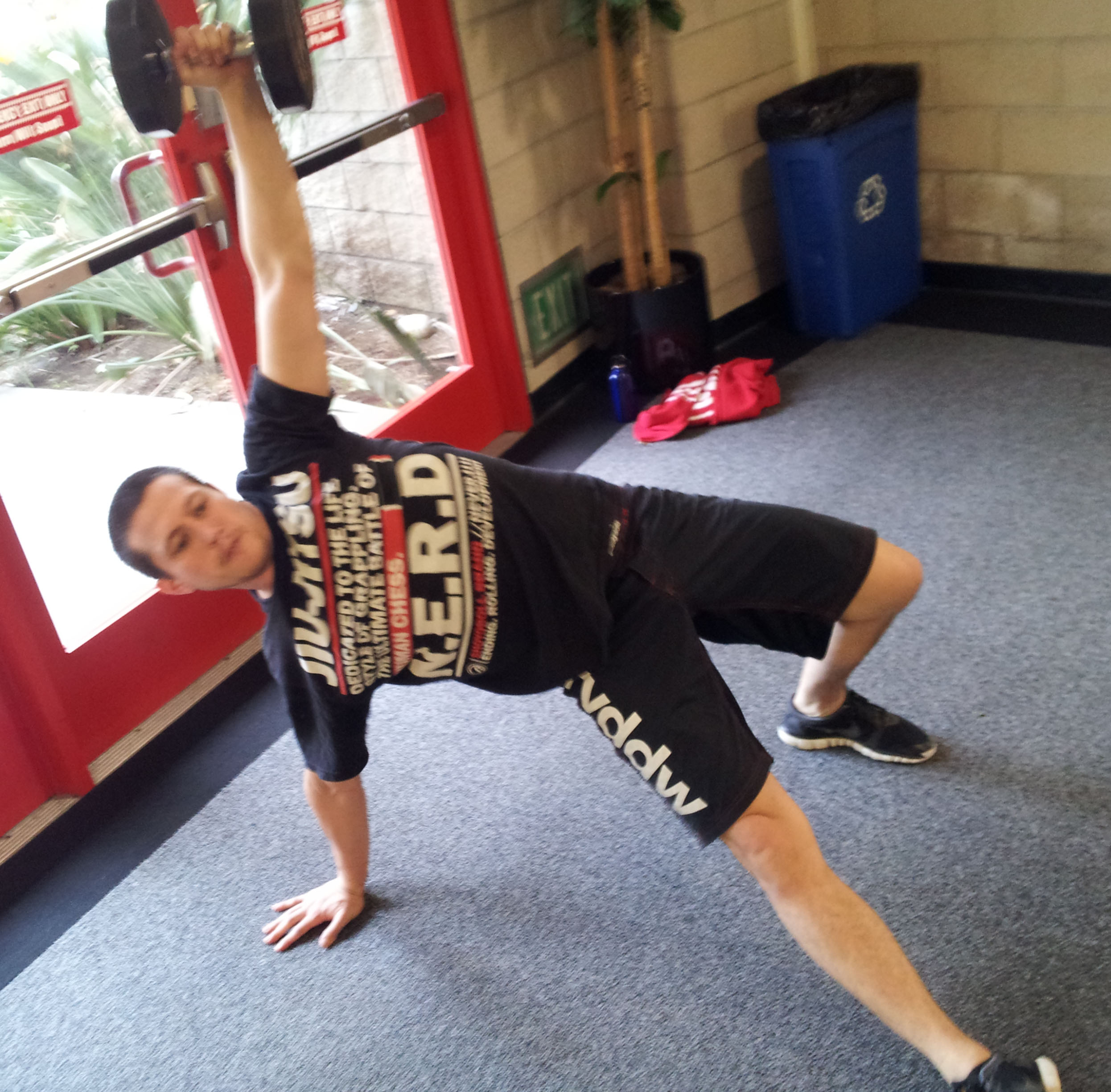 San Diego personal training client, Dominic, performing a Turkish Get Up.