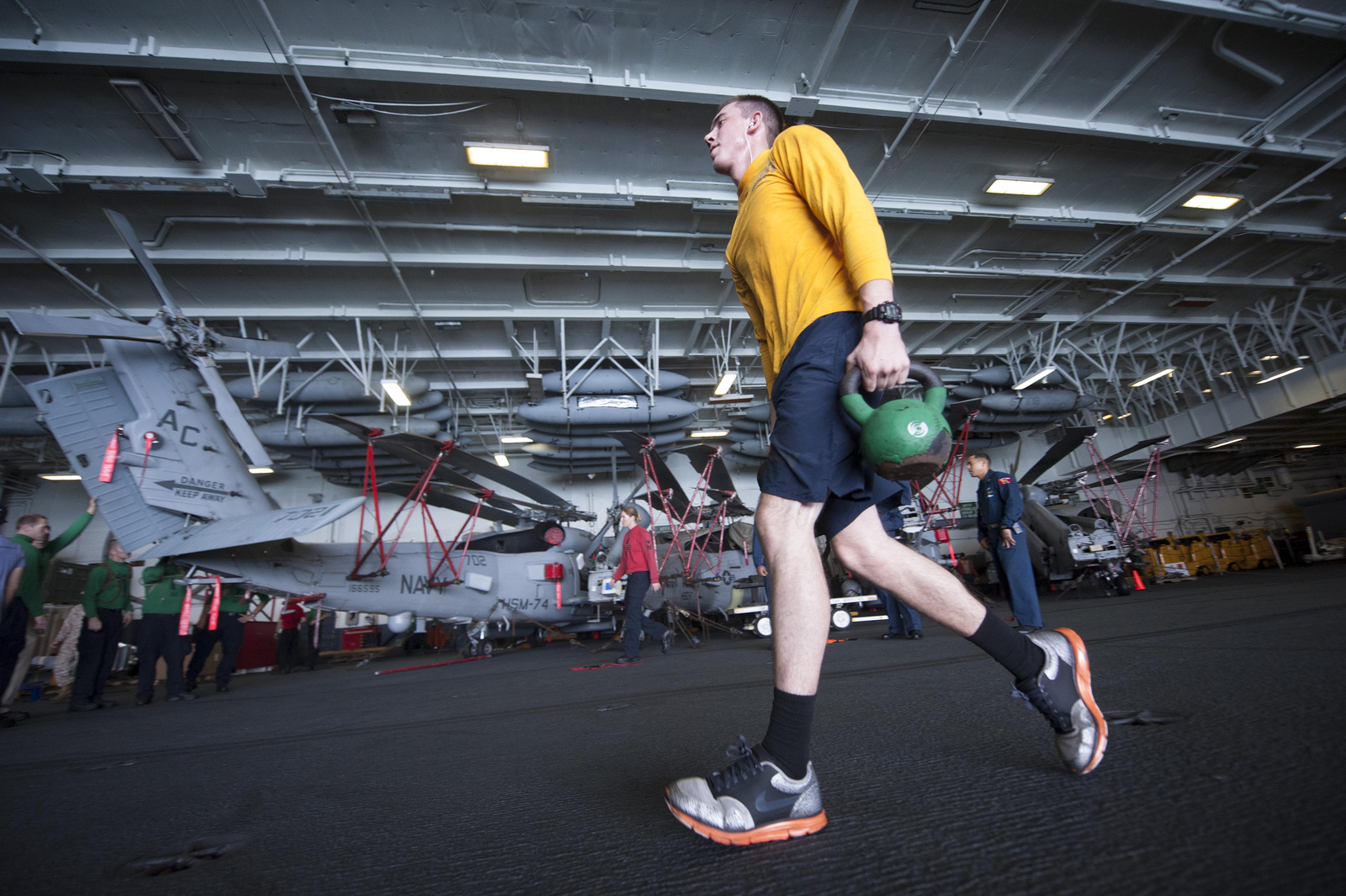 Kettlebell carries are a great way to begin including strongman style exercises for physical training.