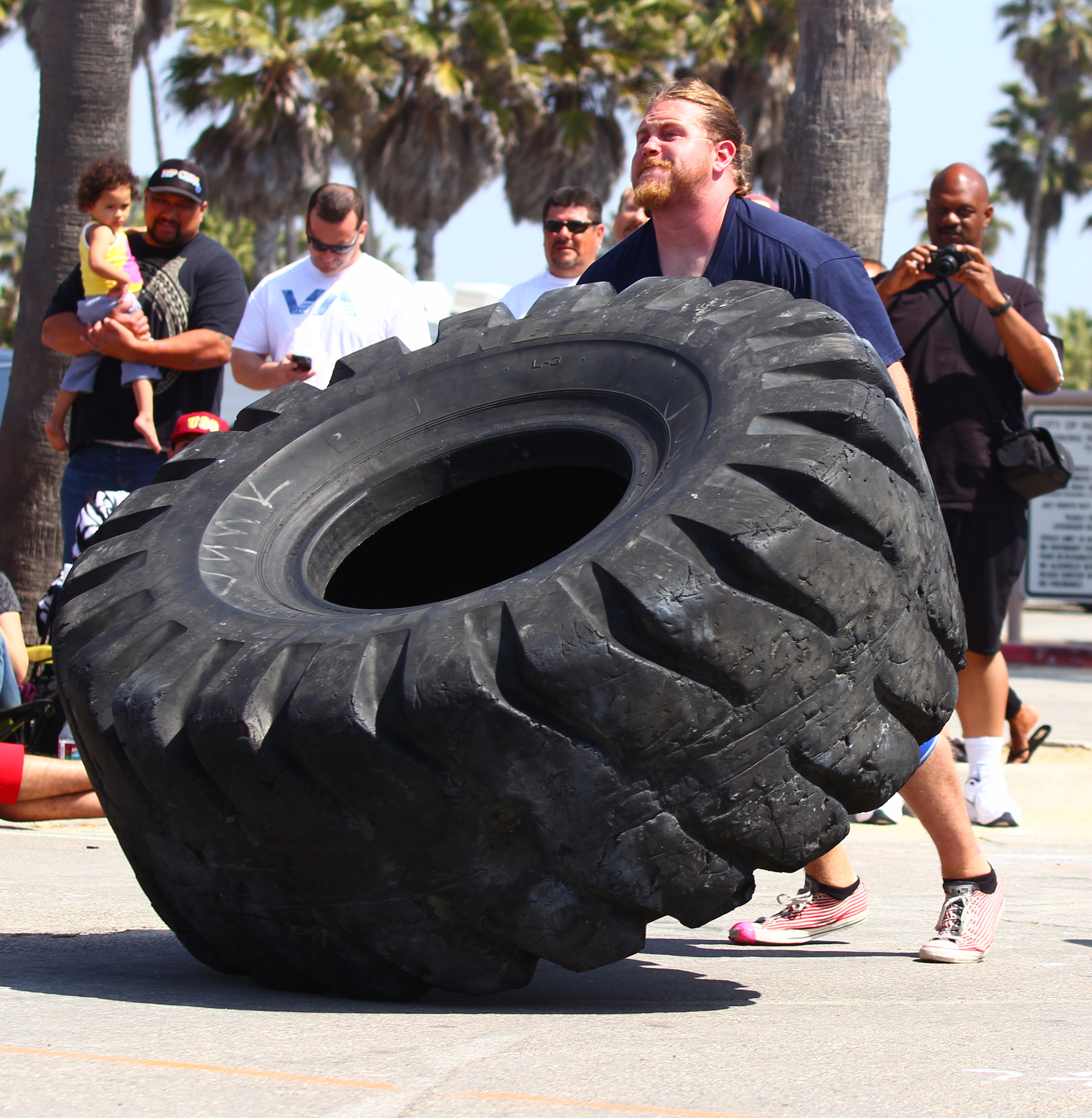 San Diego personal trainer, Ryan Burgess flipping a tire at  California's Strongest Man  2013.
