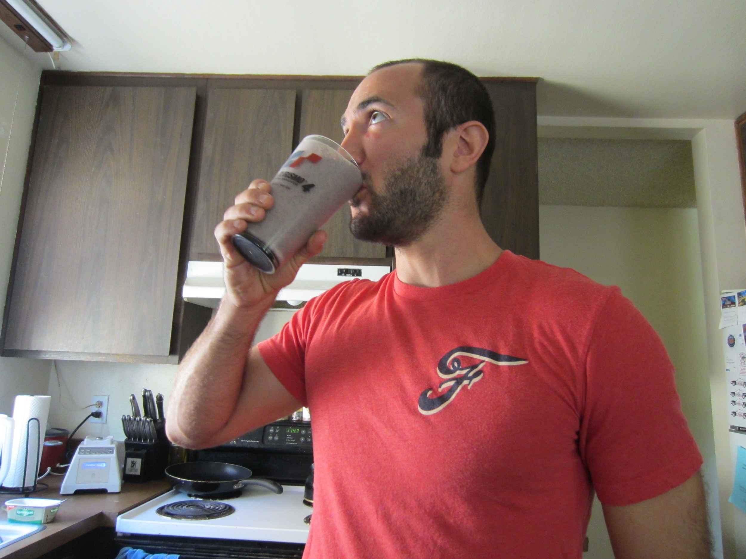 Gulping down a smoothie.