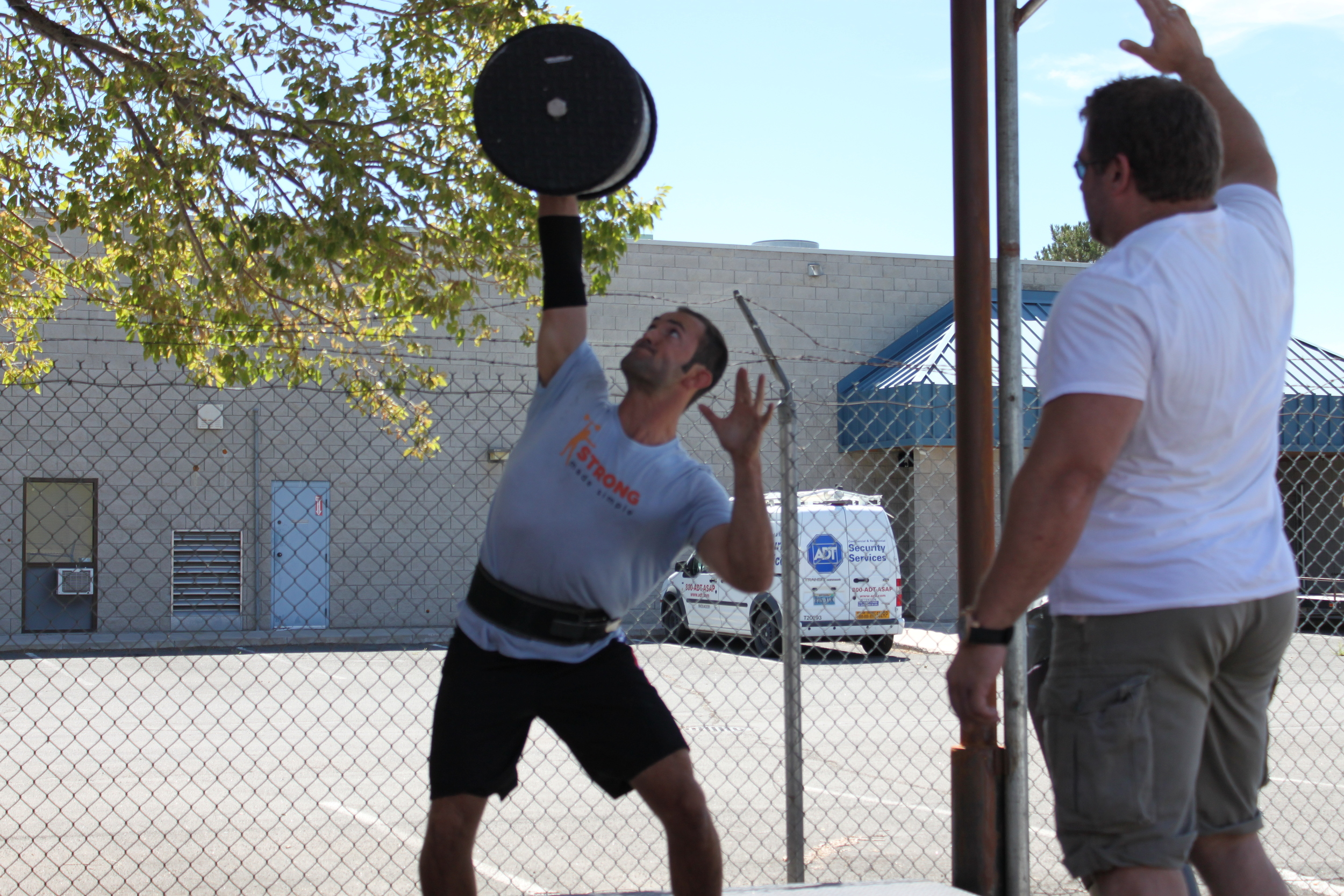San Diego personal trainer, Brian Tabor, completes a 1 arm circus dumbbell press in a strongman competition