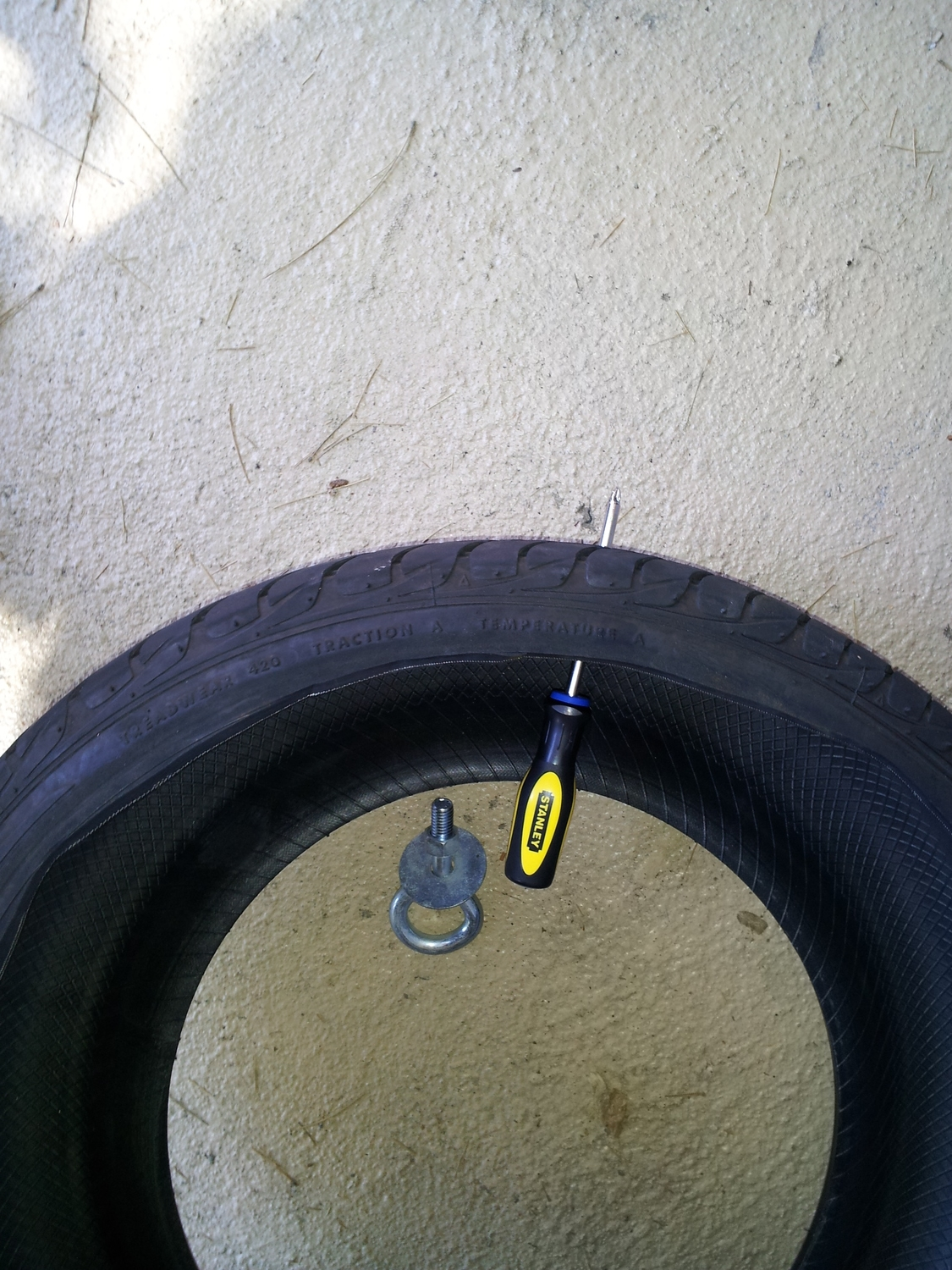 Make the hole in the tire sled for the eye bolt