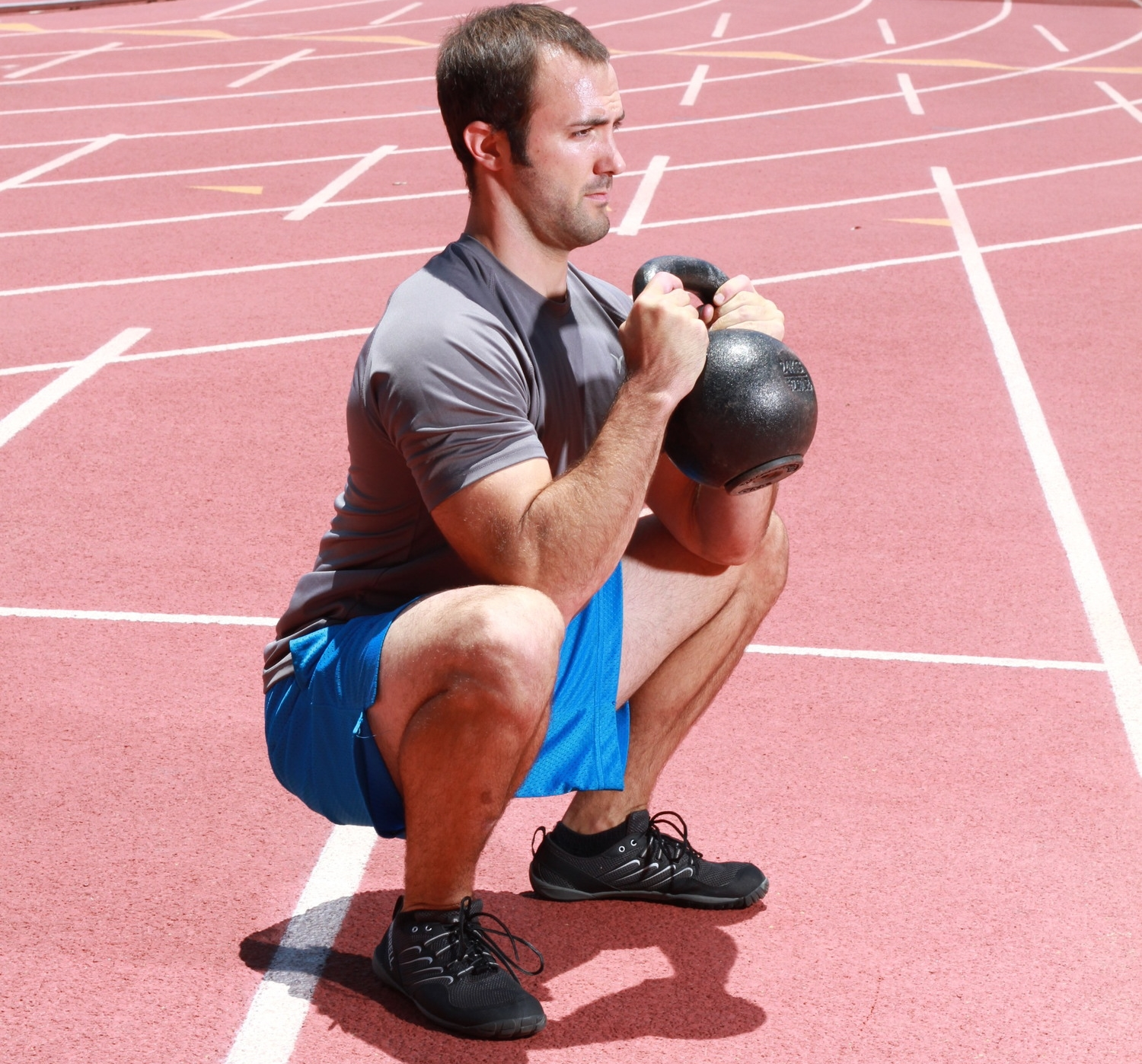 Personal trainer combining kettlebell goblet squats with a track workout in San Diego, CA. #deepsquatshappythoughts