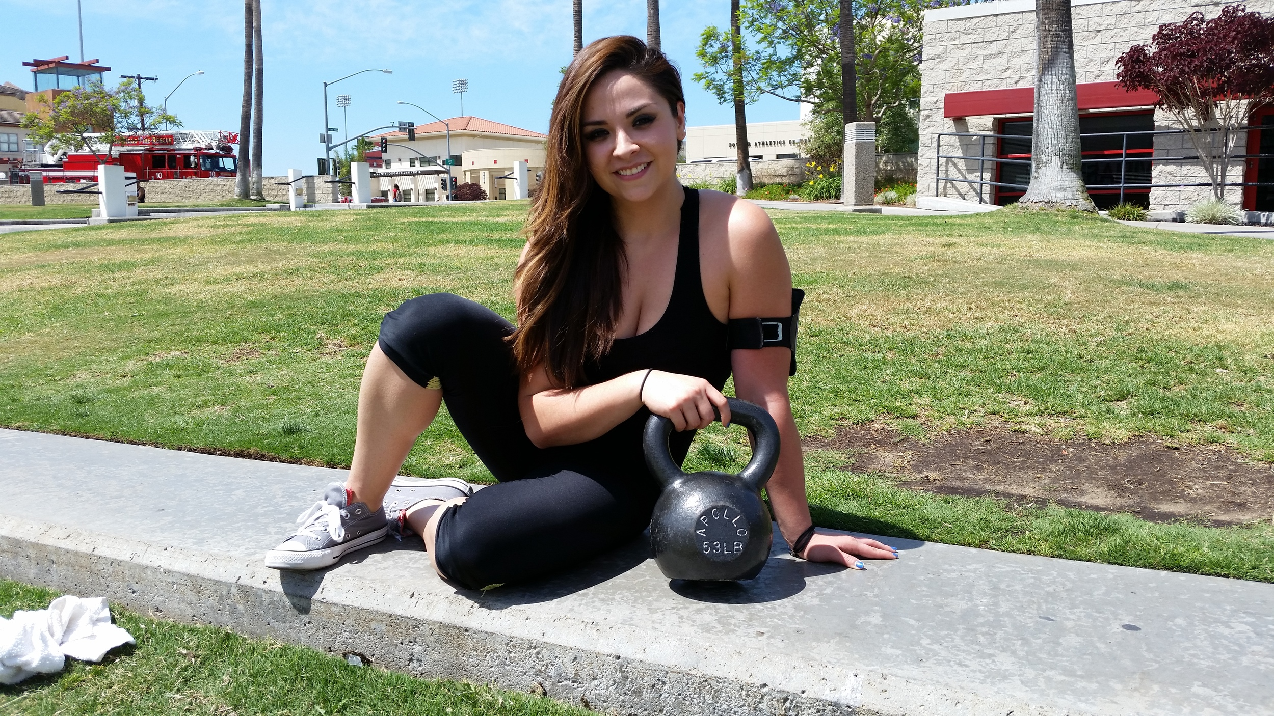 Candy likes to hang around outside with her favorite kettlebell before personal training workouts. ;-)
