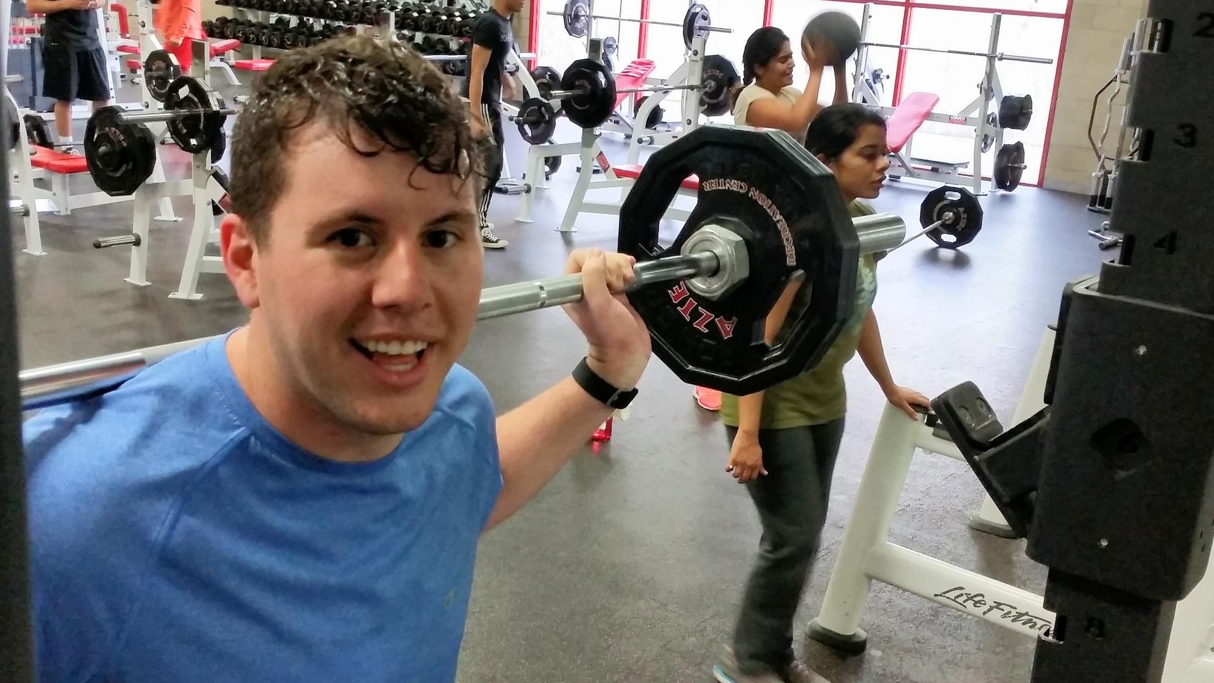 Patrick squatting at the Aztec Recreation center.