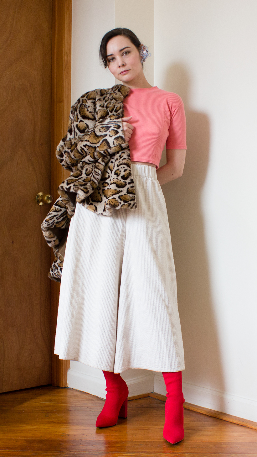 Asymmetric faux fur jacket, white wide leg pants, red sock shoes and pink short sleeve top