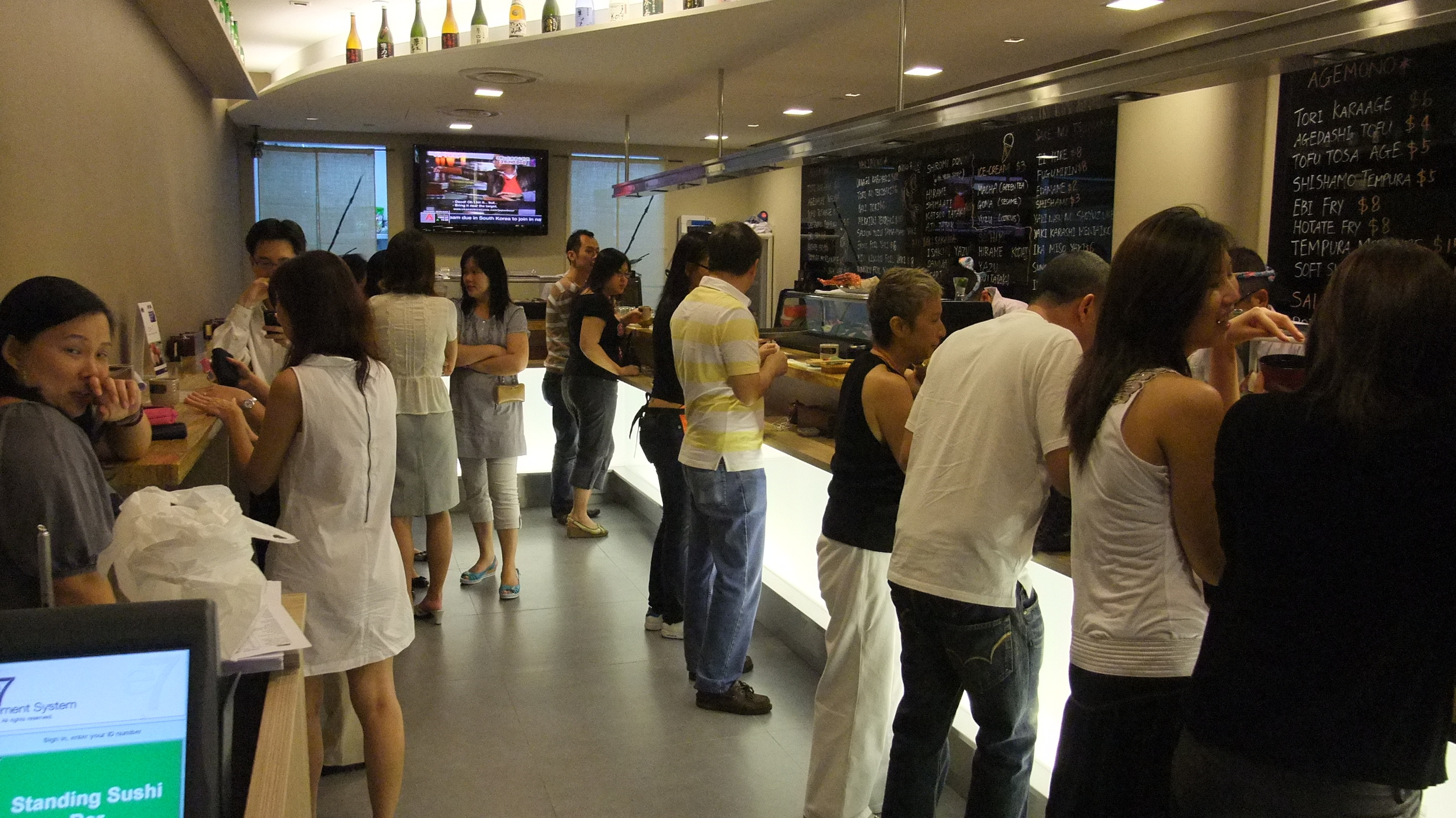 The original Singapore Standing Sushi Bar located at One Raffles Place.