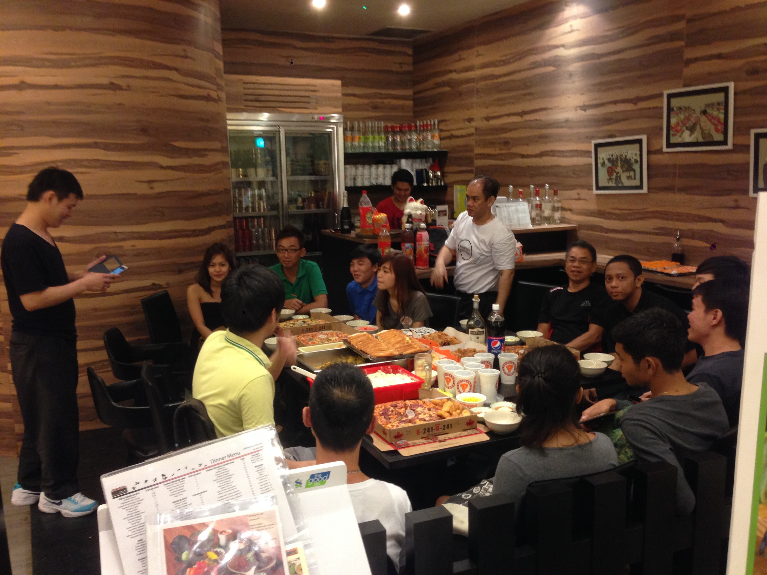 Our team at Standing Sushi Bar Marina Bay Link Mall celebrating over food!