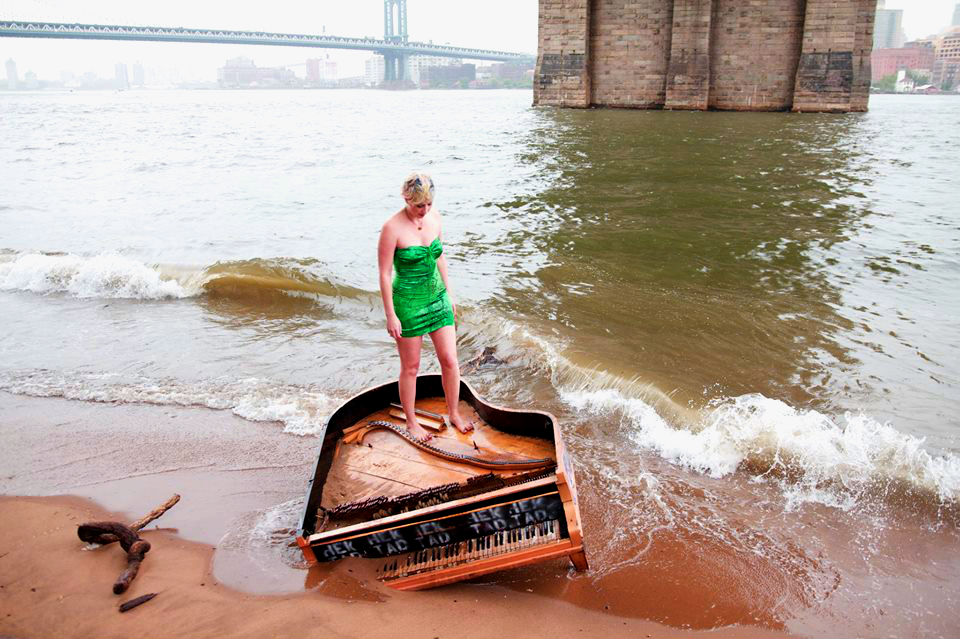 Performance artist Killy Mockstar and the East River Piano. (Photo Credit:Craig Schober)