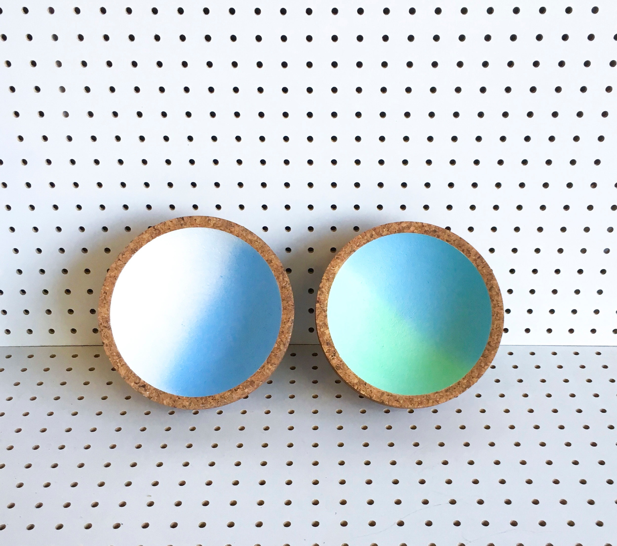 "Gennaio Bowls     Small lathe-turned bowls painted in dual tones, evoking sky, sea and spring green tones. 8"" x 3"".  SHOP"