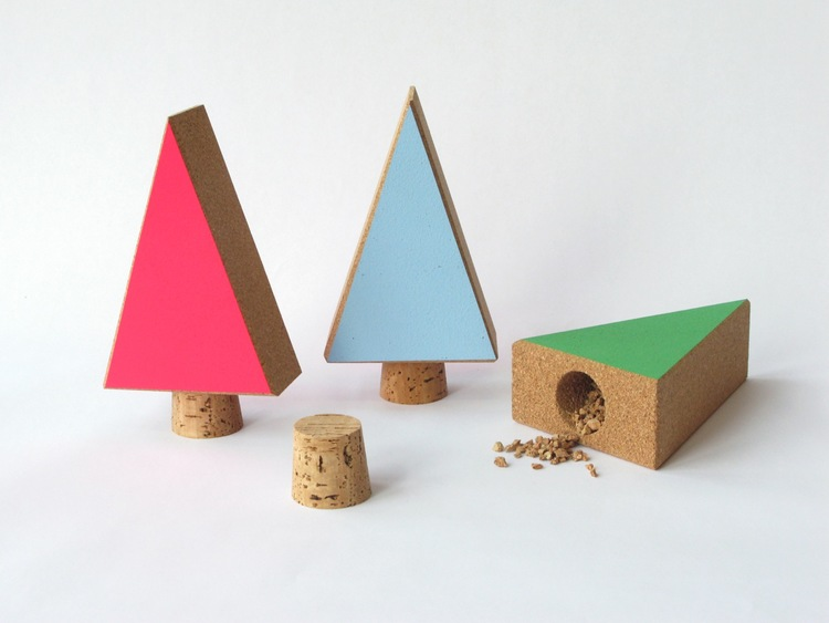 "Cork Trees     These little painted trees stand 7"" high by 4"" wide. The cork ""trunk"" is removable for secretly storing whatever it is you need to get through the holidays in one piece.  SHOP"