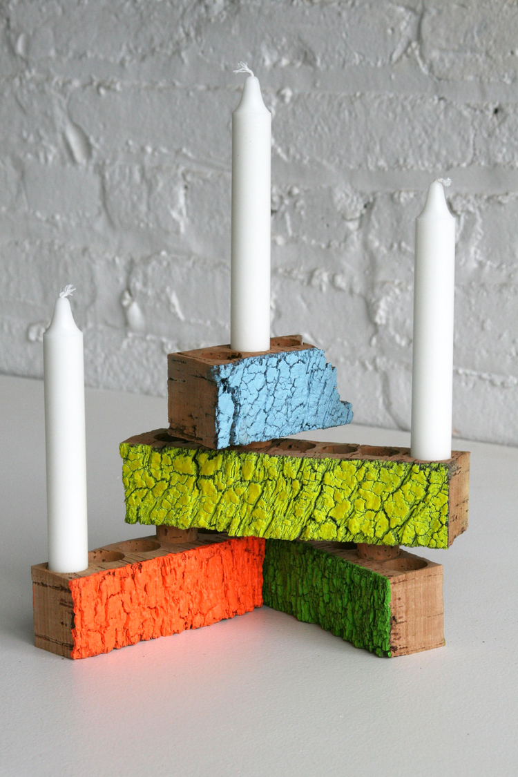 Ligado Candleholder     Made directly from the waste of cork bottle stopper production. The negative space left by punching out stoppers offers opportunities for linkage, and multiple configuration of candle mounts. Sizes variable.  SHOP
