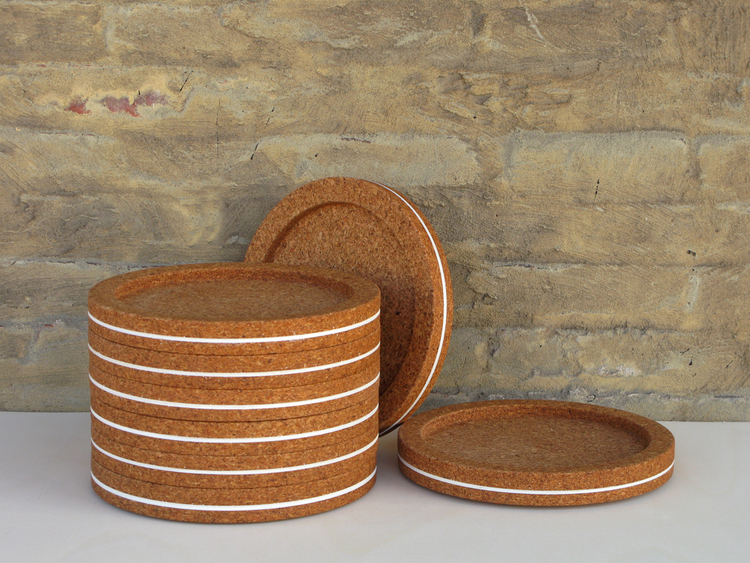 "Massimo Stacking Plates     Inspired by the Massimo Vignelli melamine plates I grew up using. The material experience is now warm and natural with a subtle accent of color. High-density cork and paint. Hand-washable. 11.75"" x 1.5""  SHOP"