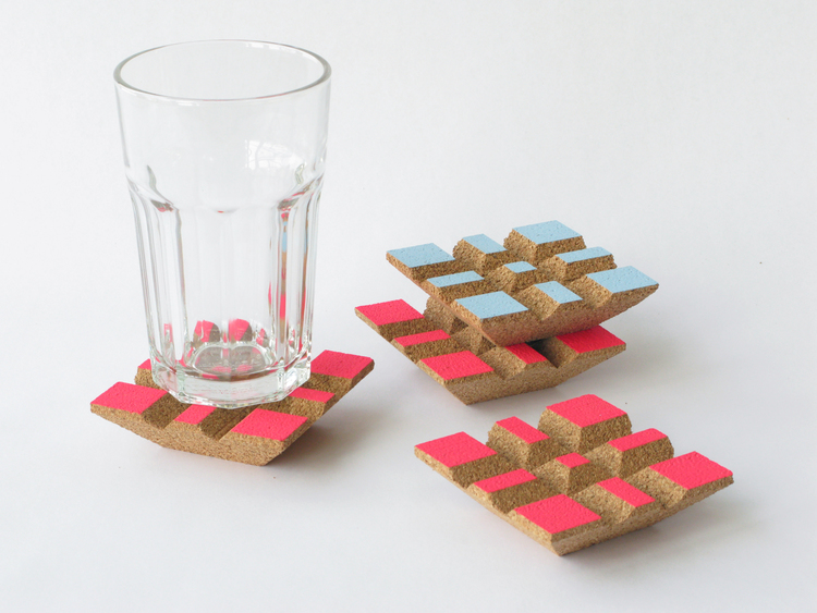 Praia Coaster Set    These coasters come in a pack of 4, and are offered in 3 colorways: all have natural cork with either Sky Blue, Light Grey or Electric Pink paint. Hand wash.  SHOP