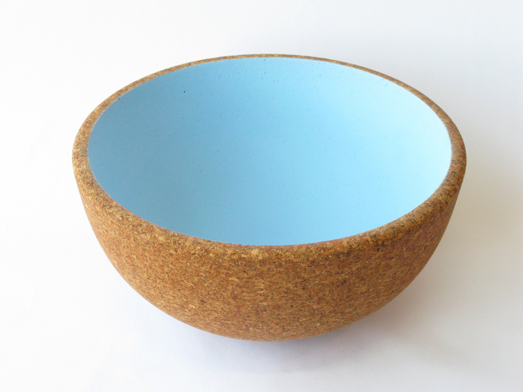 "Praia Bowl     These tabletop display bowls are natural cork on the outside and cool, pastel colors on the inside. For display use only. Hand washable. 12"" x 6"" - recycled cork, paint.  SHOP"